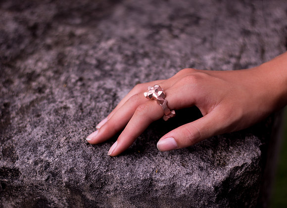 NUGGET x ROSE ring on woman's hand side view on rock